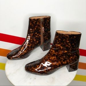 Urban Outfitters tortoise glossy booties